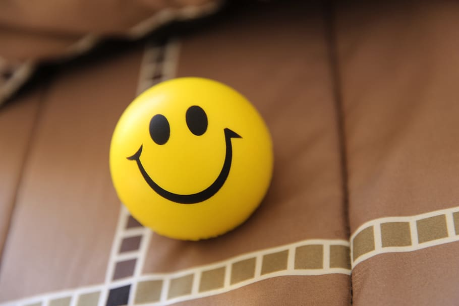 HD wallpaper anthropomorphic smiley face smiling yellow close 910x607