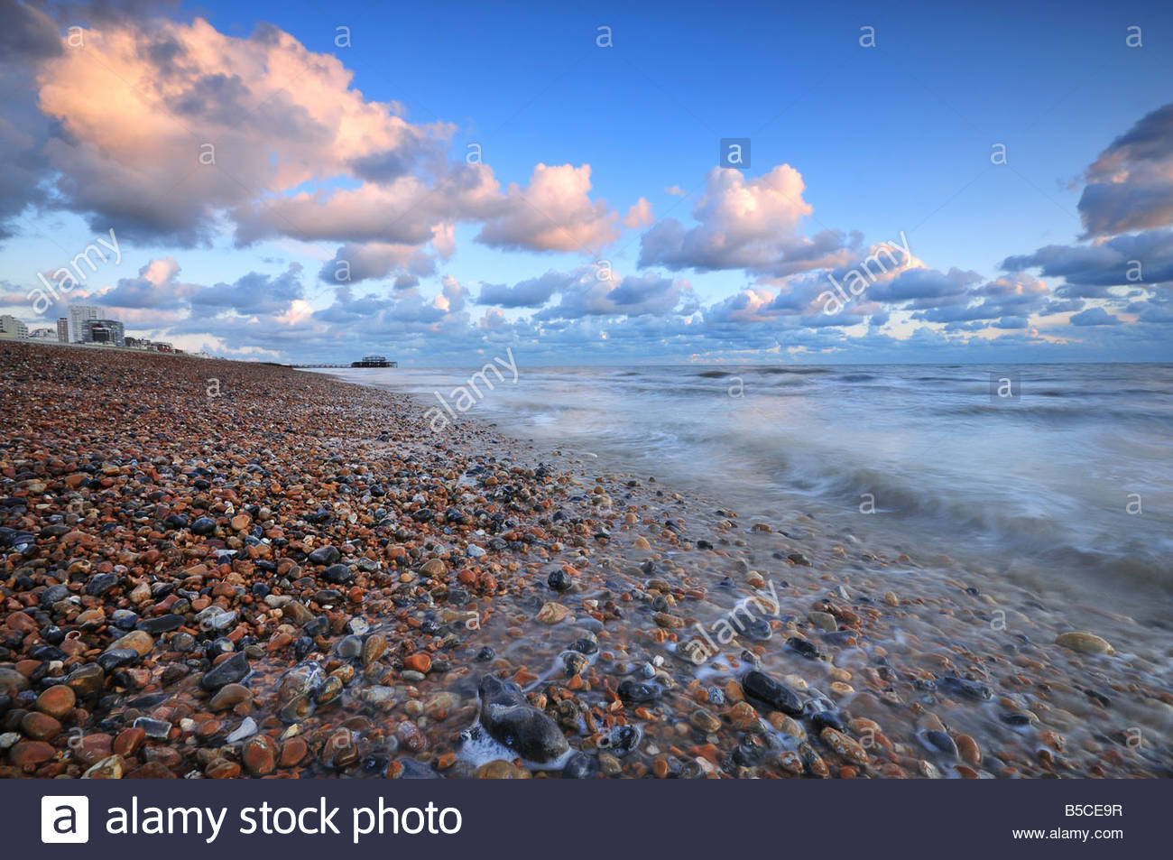 Brighton and Hove beach with pebbles and stones West Pier in the 1300x953
