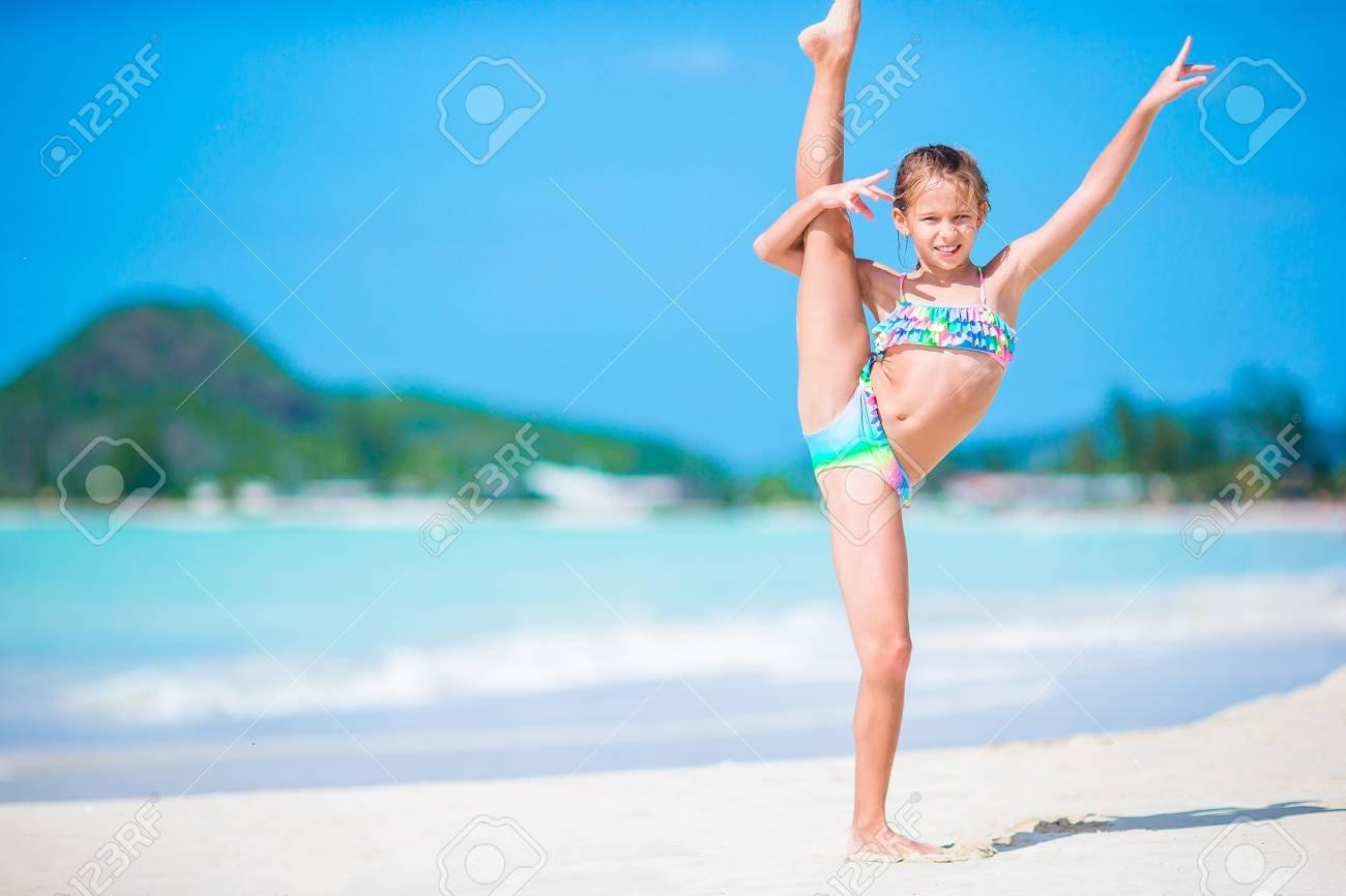Beautiful Little Girl On Beach Having Fun Happy Girl Enjoy Summer 1300x866