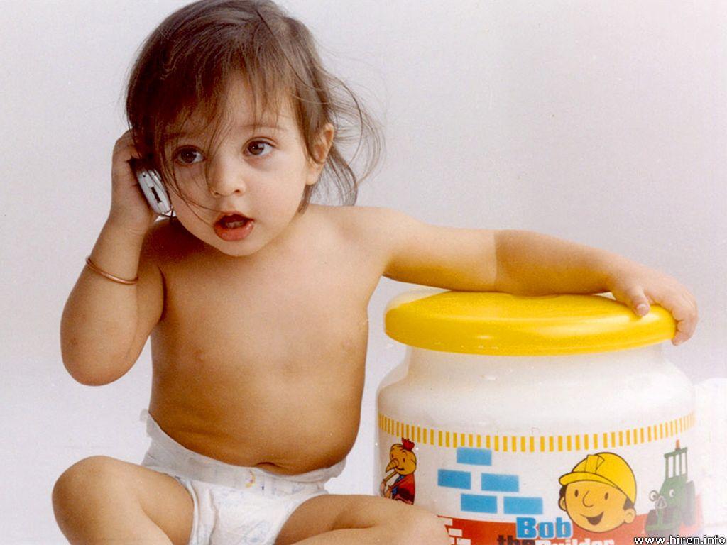 Cute Baby Talking On Phone 1024x768