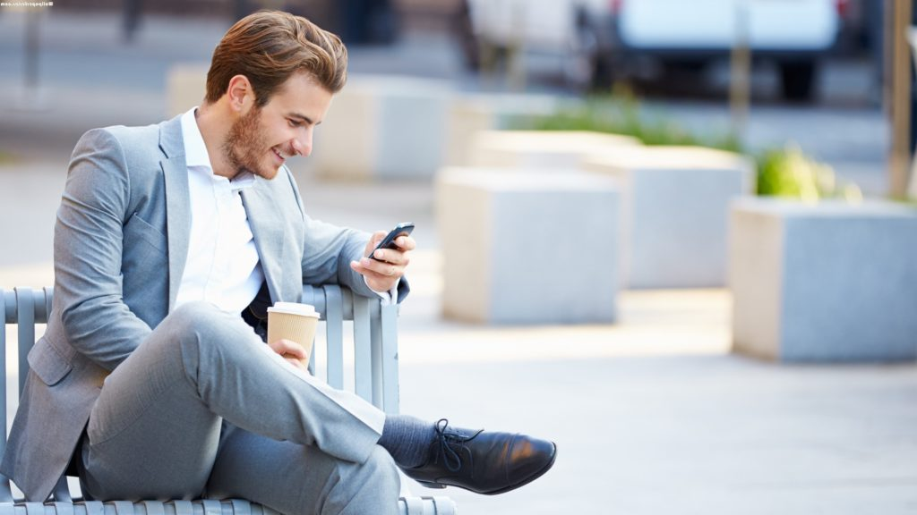 Handsome Man In Suit Texting Wallpaper e1436199198265   The Social Lit 1024x576