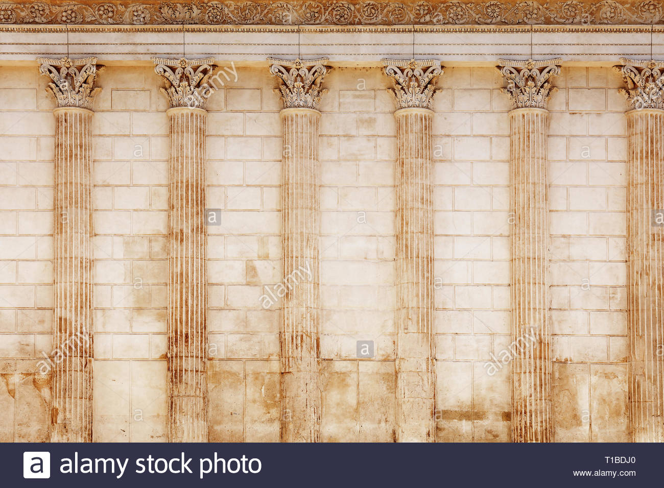 Background of antique Roman temple wall with Corinthian columns of 1300x956
