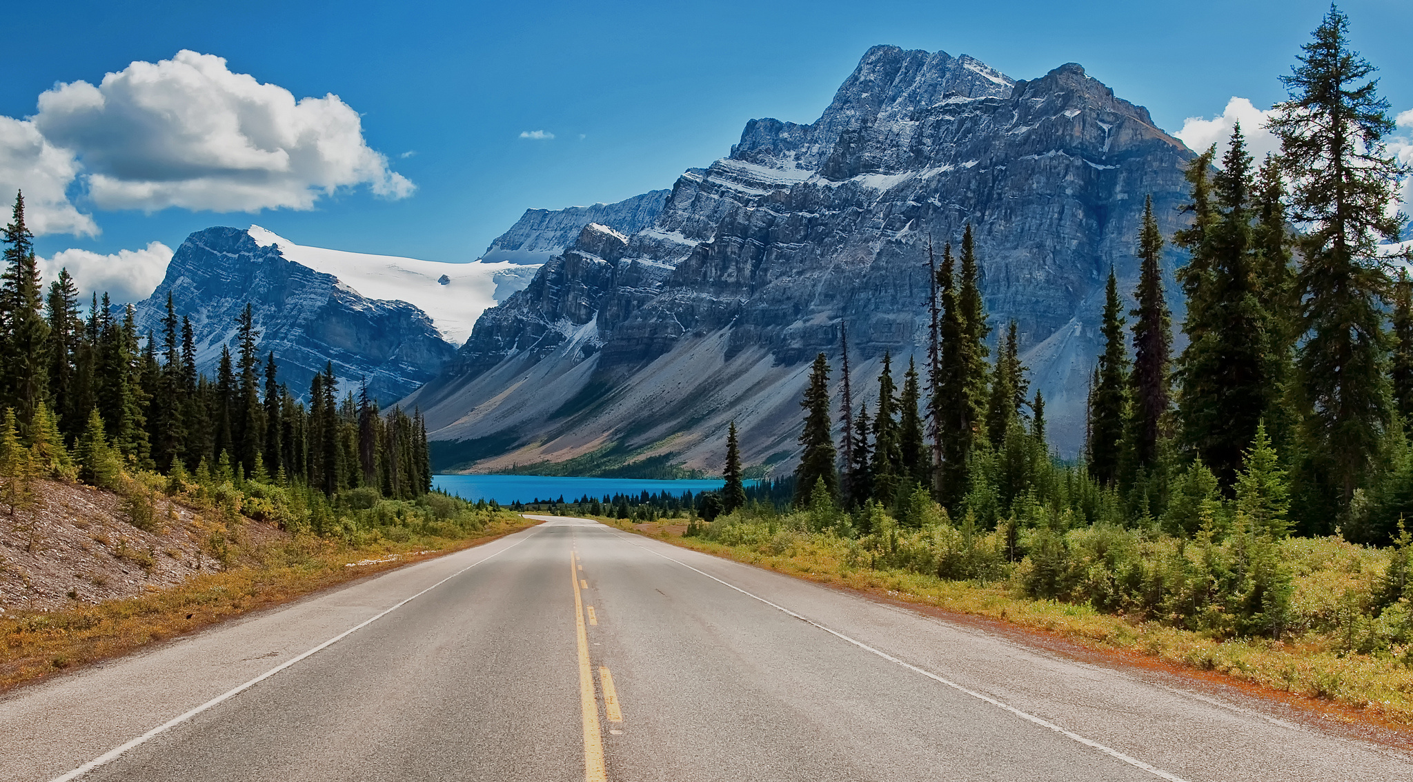 Canada Canadian Rockies road trees lake mountains wallpaper background 2048x1134