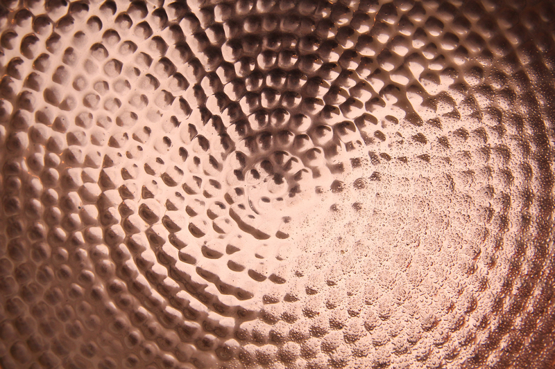 Textures shiney copper metal texture pitted bowl water drop wallpaper 800x533