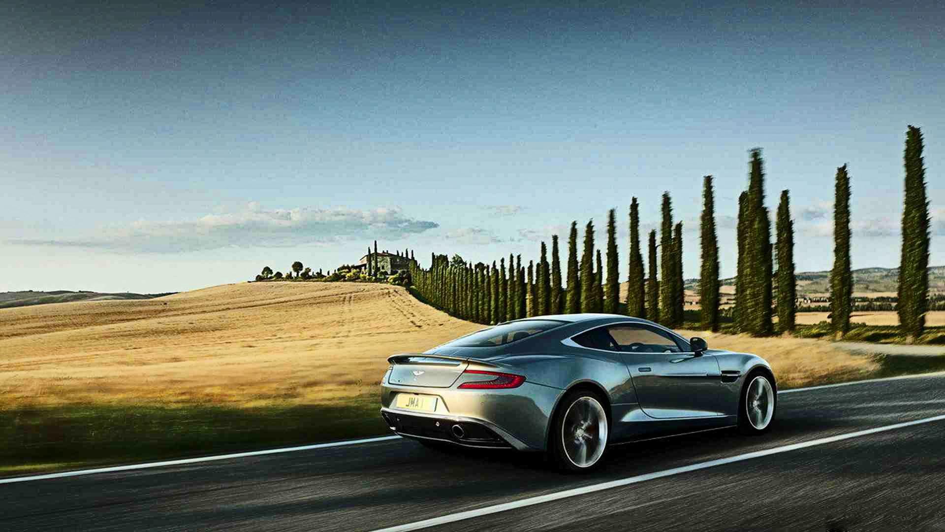 синий автомобиль Aston Martin  № 2593839 бесплатно
