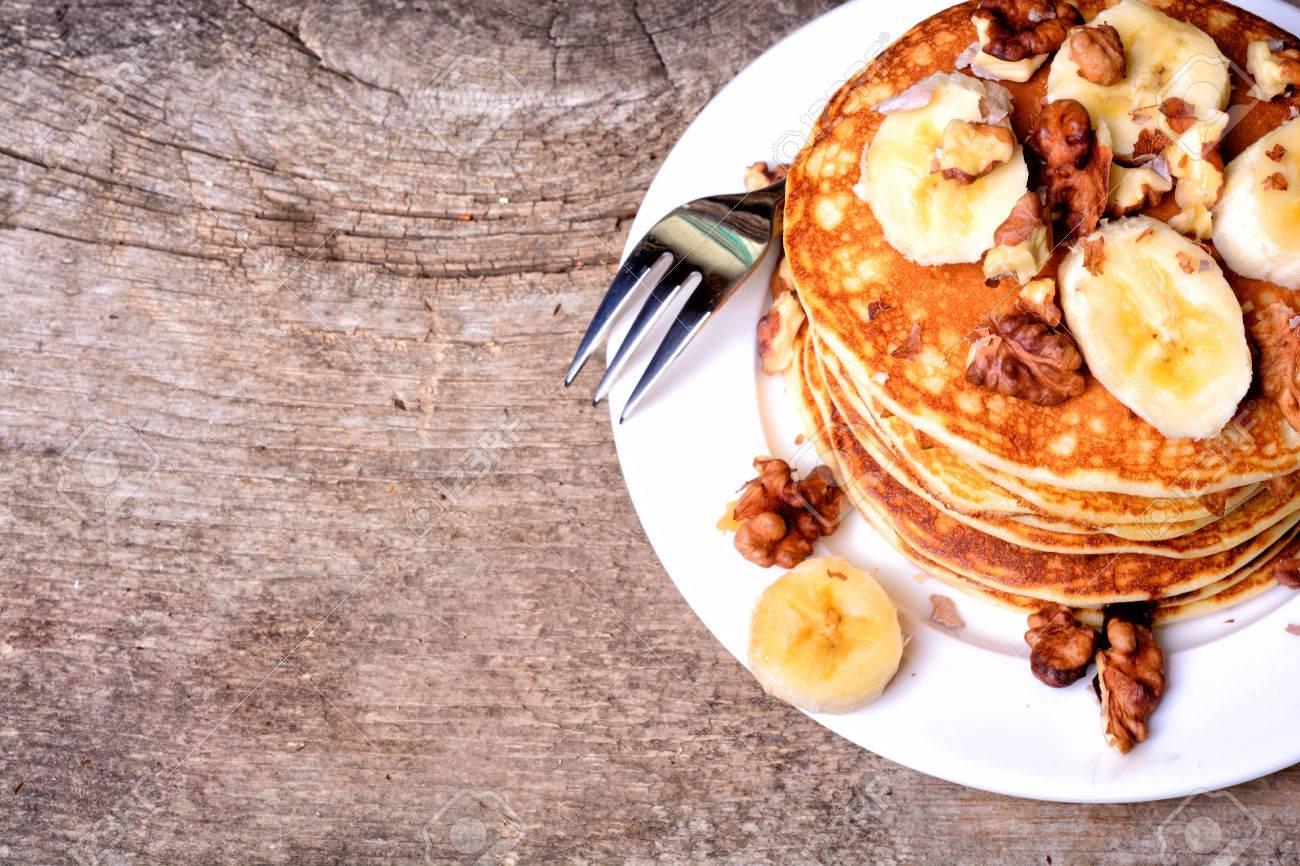 Pancakes With Banana Walnut On Wood Background Stock Photo 1300x866