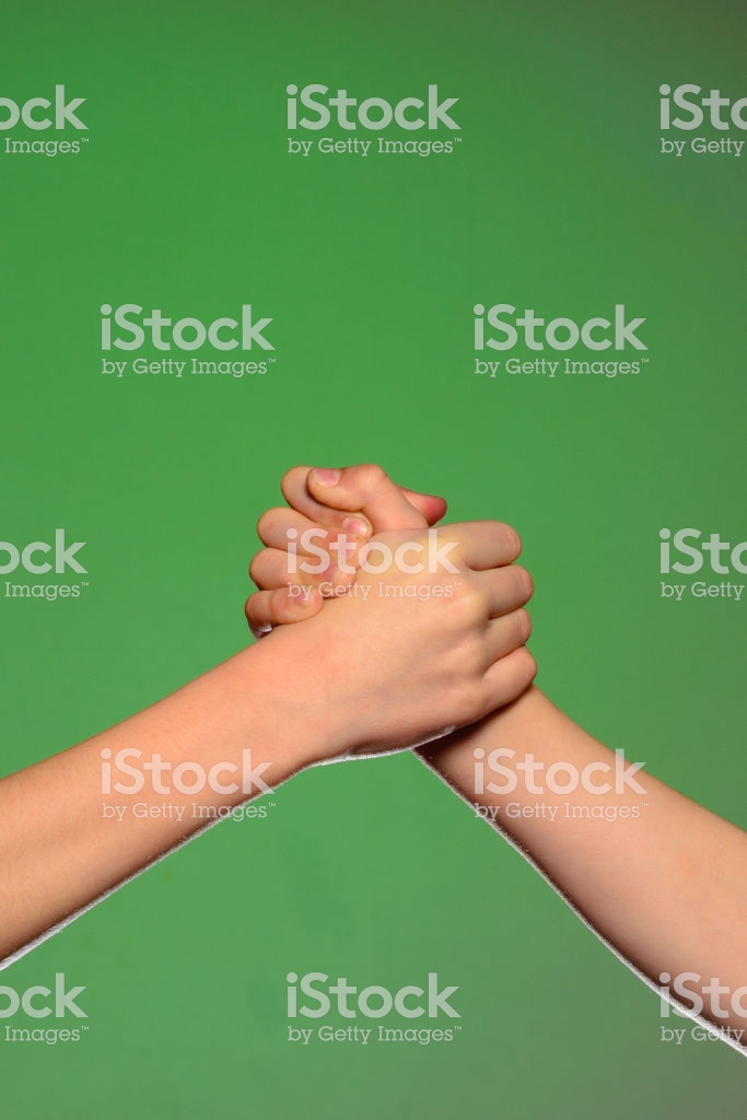 Two Hands Handshake Isolated On A Green Background Symbolizing 683x1024