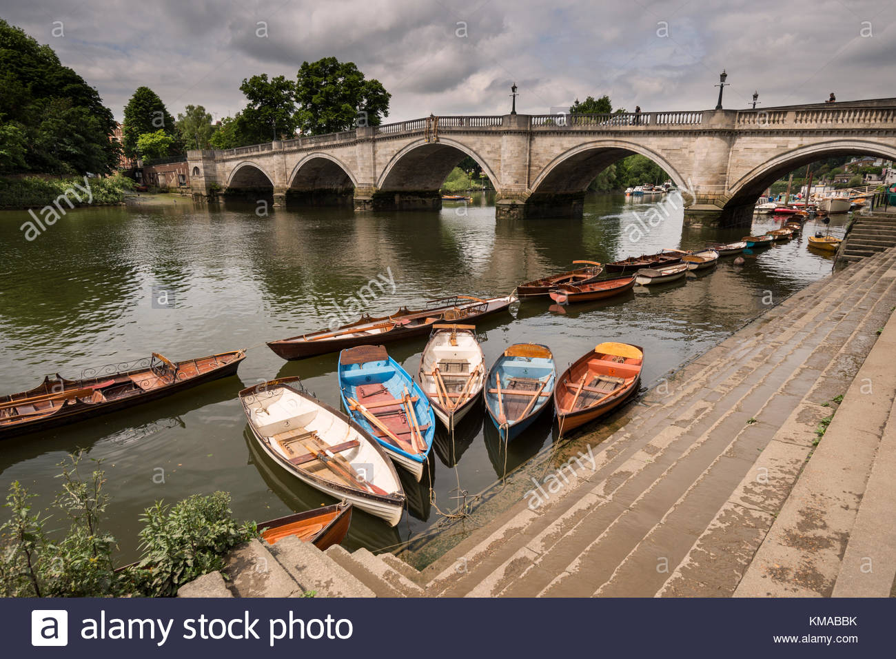 Moored rowing boats with Richmond Bridge in the background London 1300x956