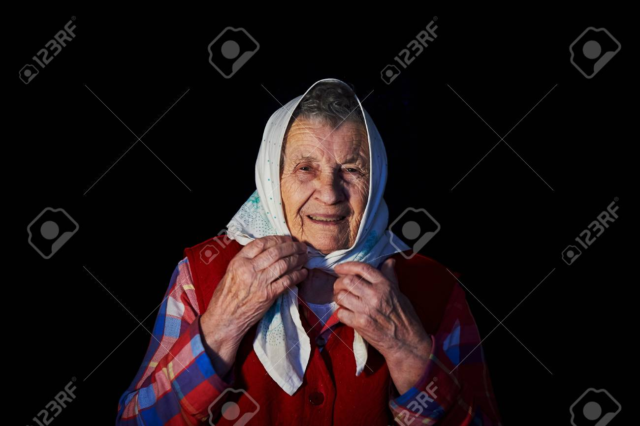 Old Granny On A Black Background Ties The Handkerchief Stock 1300x866