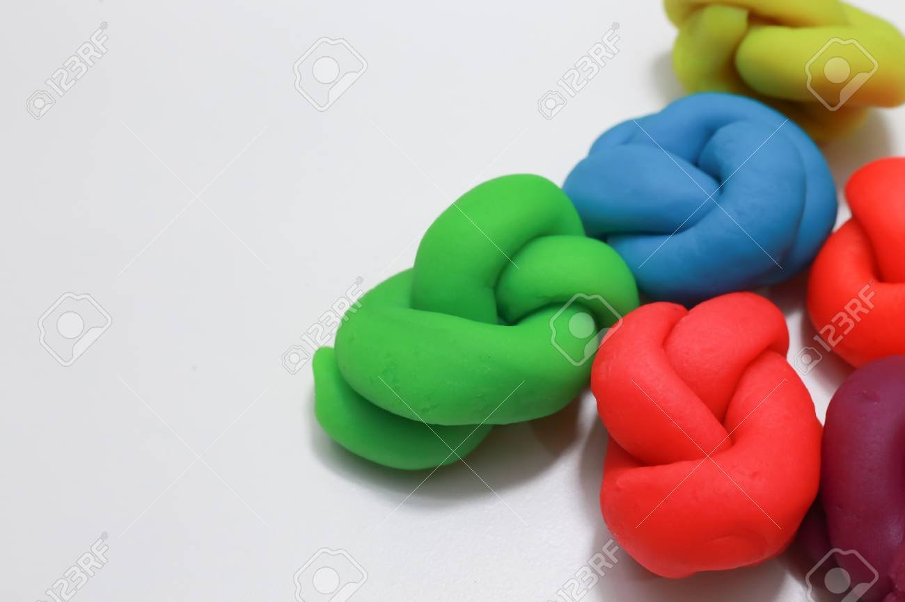 The Colorful Playdough Close Up Image On White Background Stock 1300x866
