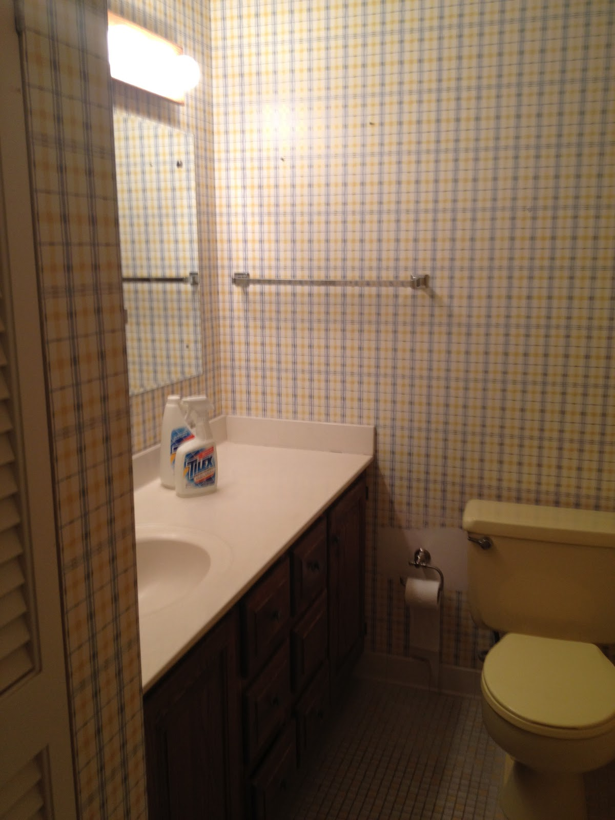 Very 90s Waverly plaid wallpaper and dull brown oak cabinets 1200x1600
