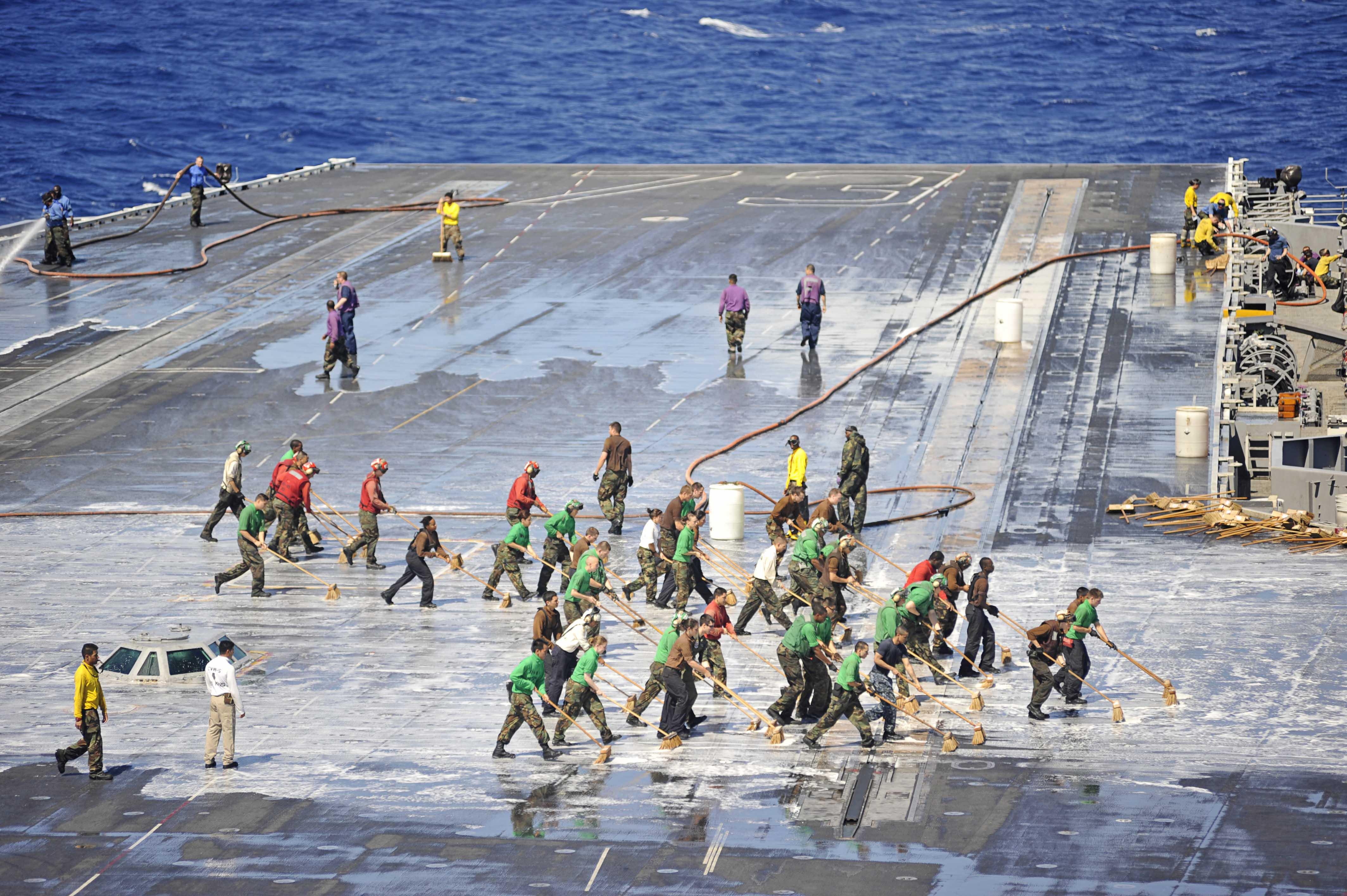 FileUS Navy 110824 N BR887 045 Sailors wash down the flight deck 4256x2832