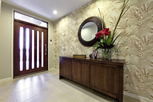 feature wall entrance ties in with the tropical resort theme of this 580x387