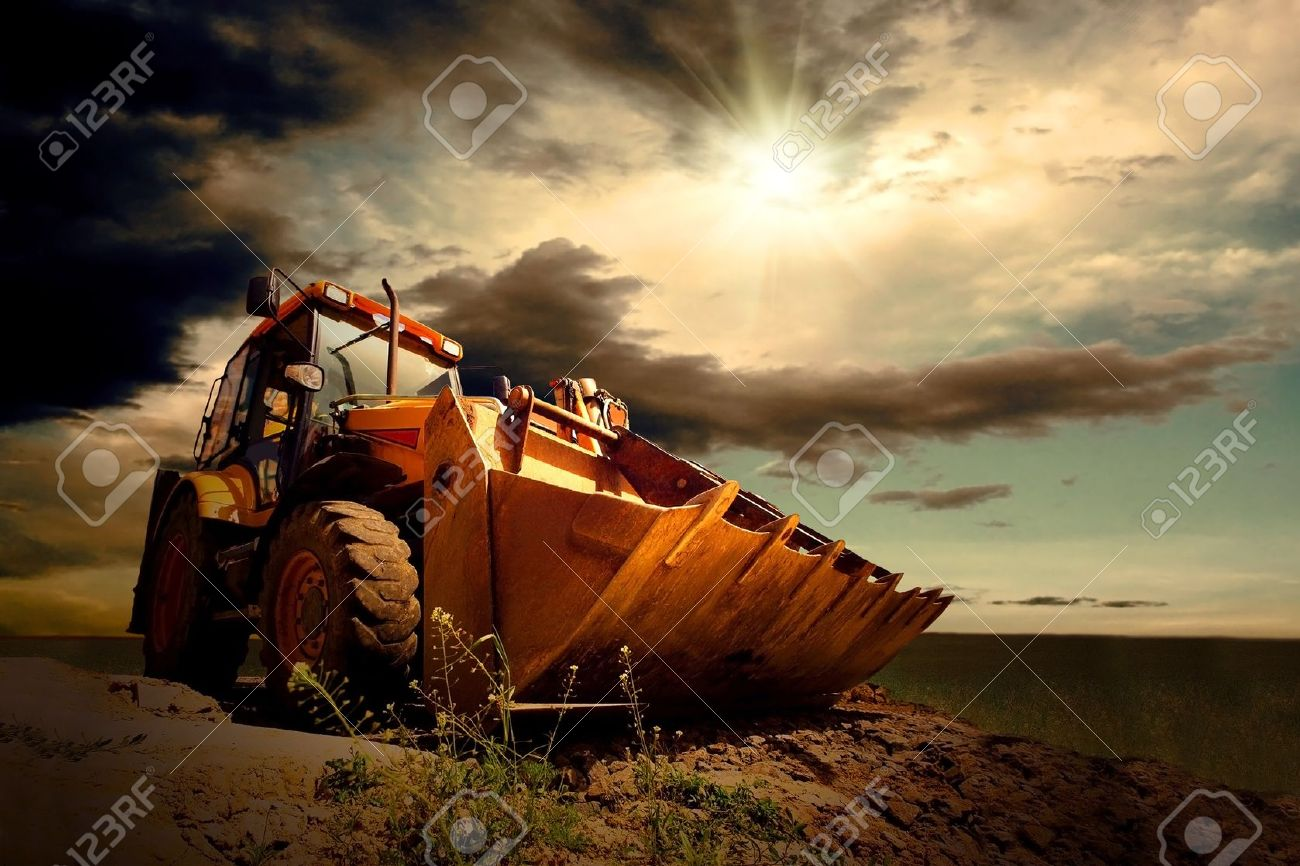 Yellow Tractor On Sky Background Stock Photo Picture And Royalty 1300x866