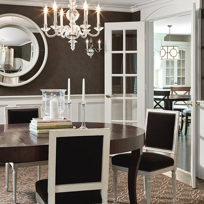 dramatic dining room brown paint wallpaper white wainscoting 670x670