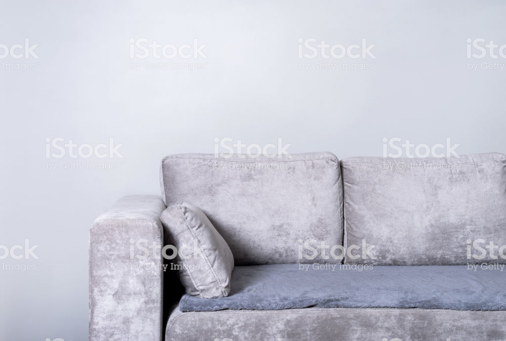 Comfortable Sofa On Grey Wall Background Living Room Stock Photo 1024x690