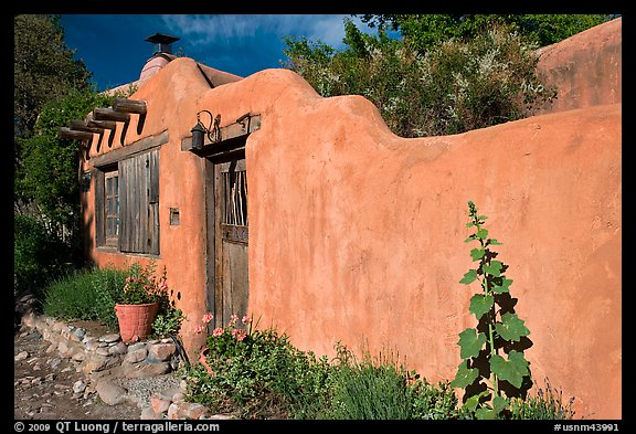 wall and weathered wooden door and window Santa Fe New Mexico USA 576x393