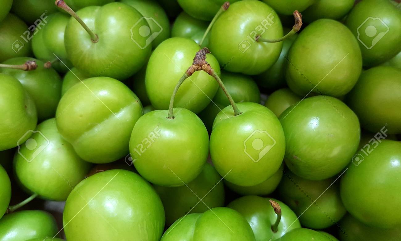 Close up View Of Fresh Green Plums Cherry plum Background Stock 1300x782