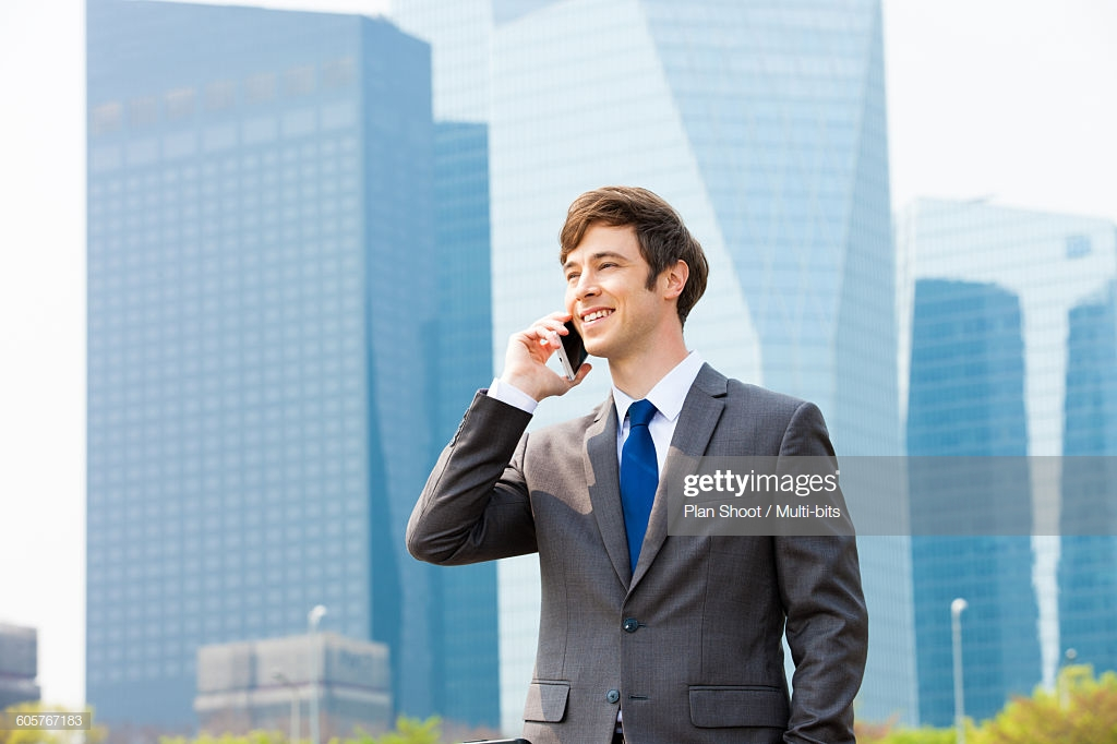 Mobile Phone With Building As A Background And Business Foreigner 1024x682