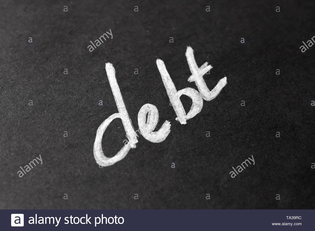 Word DEBT on dark background Stock Photo 247165280   Alamy 1300x956