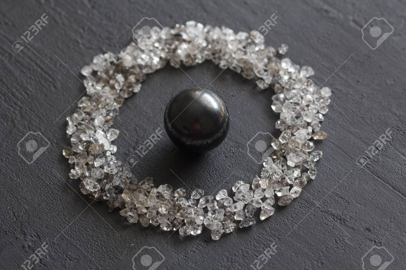 Scattered Diamonds On A Black Background Raw Diamonds And Mining 1300x866