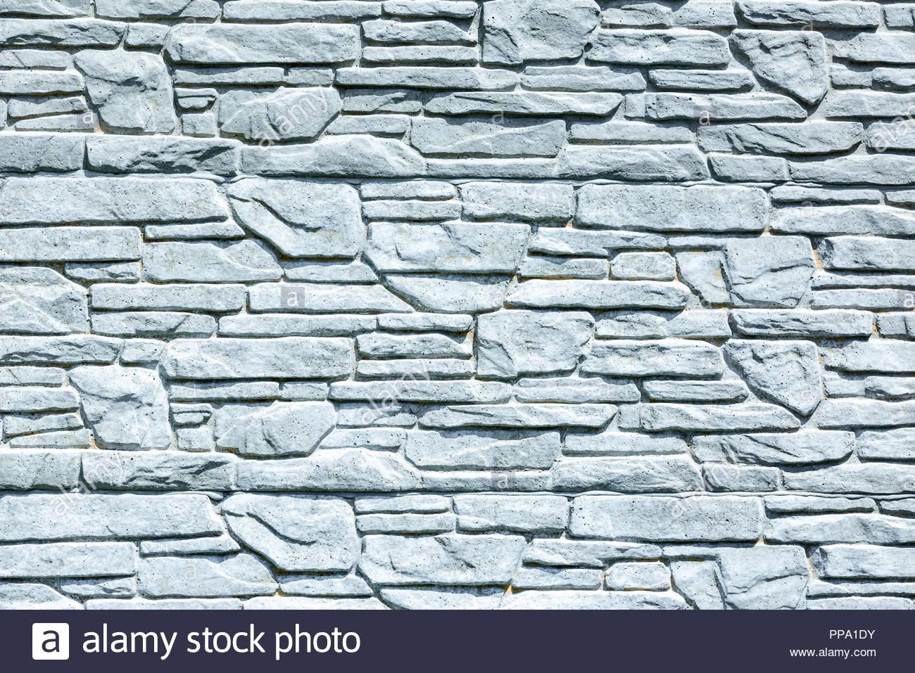 white brick wall background grungy rusty blocks of stonework 1300x957