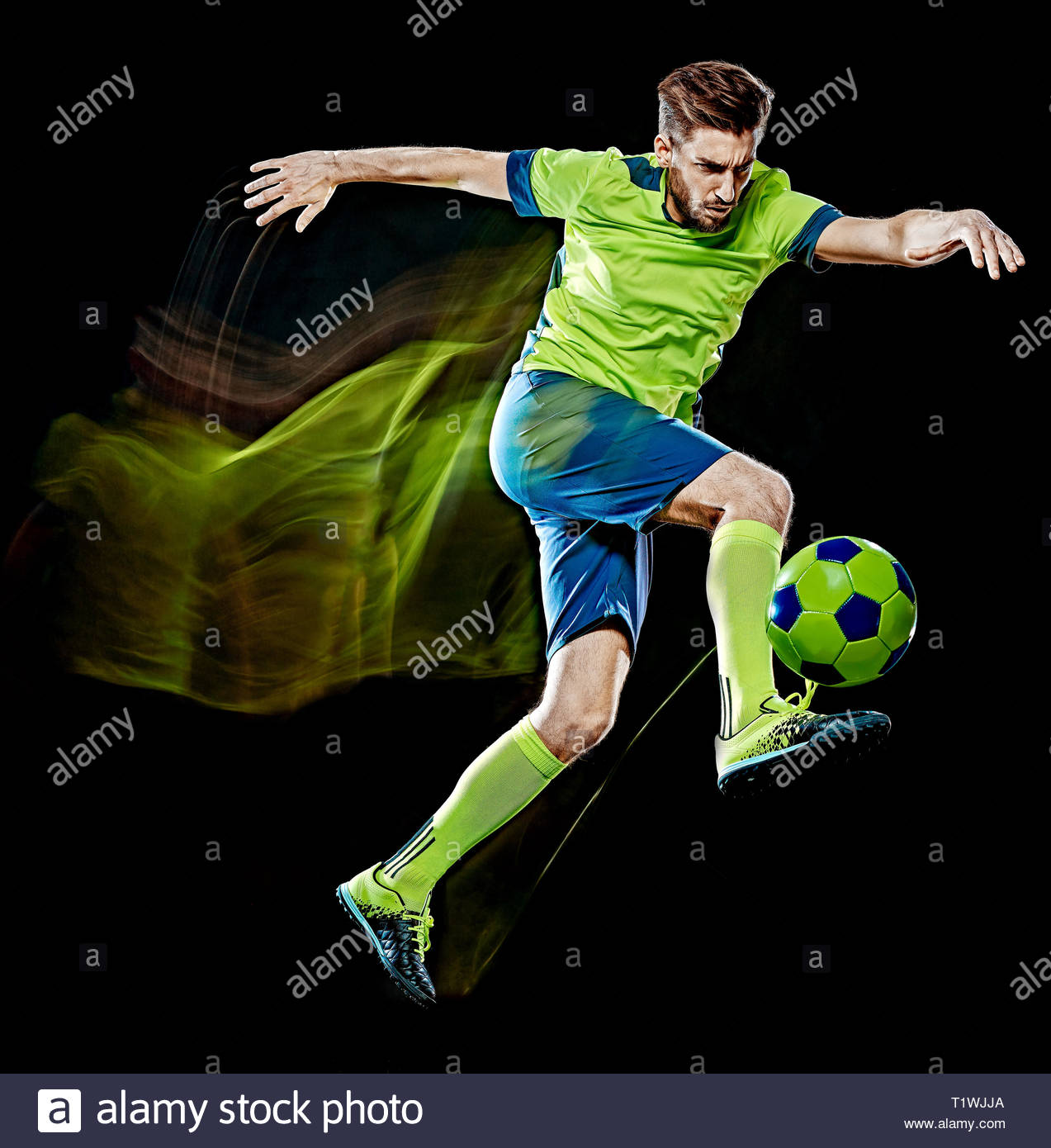 one caucasian soccer player man isolated on black background with 1273x1390