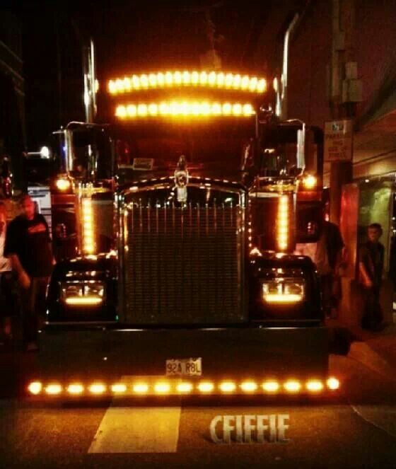 Big rig at night with Chicken lights 560x663