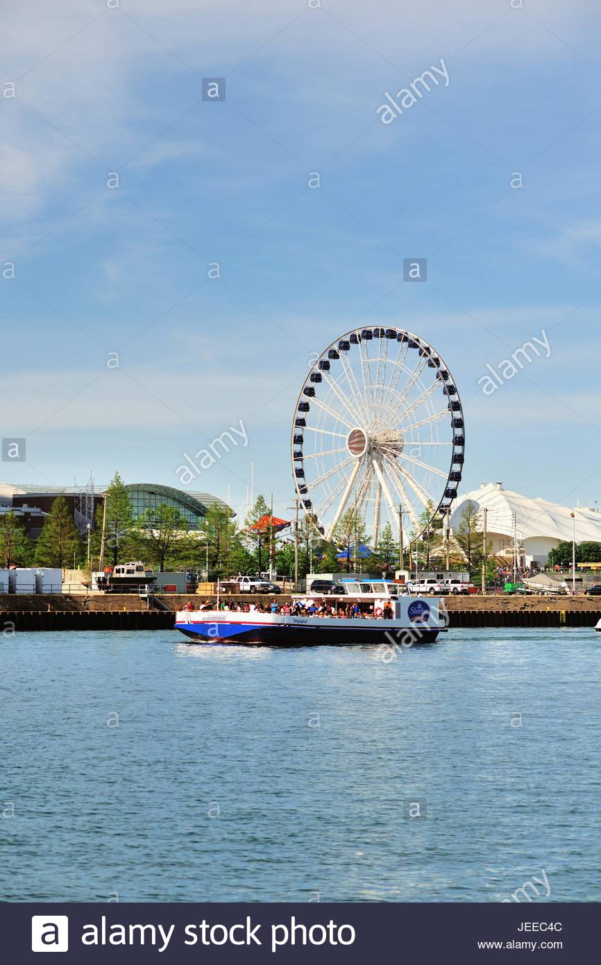 A sightseeing boat headed for Chicagos Navy Pier In the 866x1390