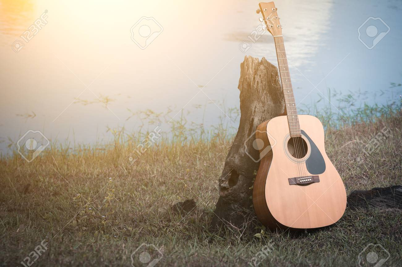 Acoustic Guitar Background On Riverside Stock Photo Picture And 1300x866