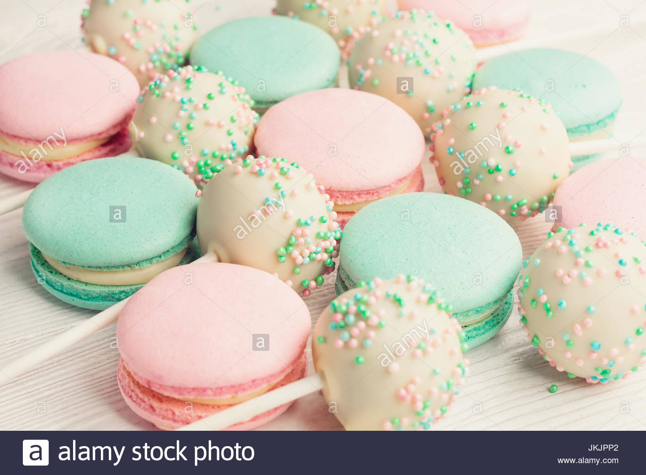Background of macarons and cake pops on sticks Stock Photo 1300x956