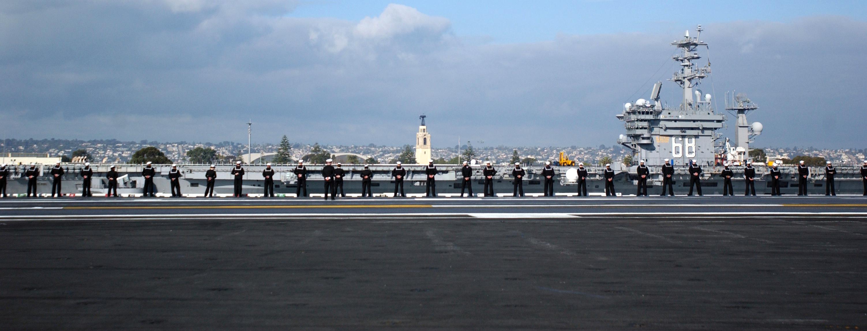 US Navy 070127 N 4776G 249 With USS Nimitz CVN 68 in the background 3006x1148