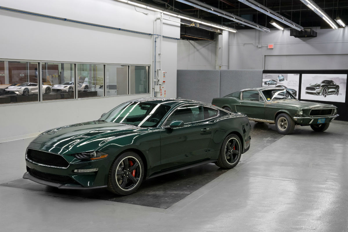 green 2019 Ford Mustang Bullitt parked with a 1968 Ford Mustang GT 1200x800