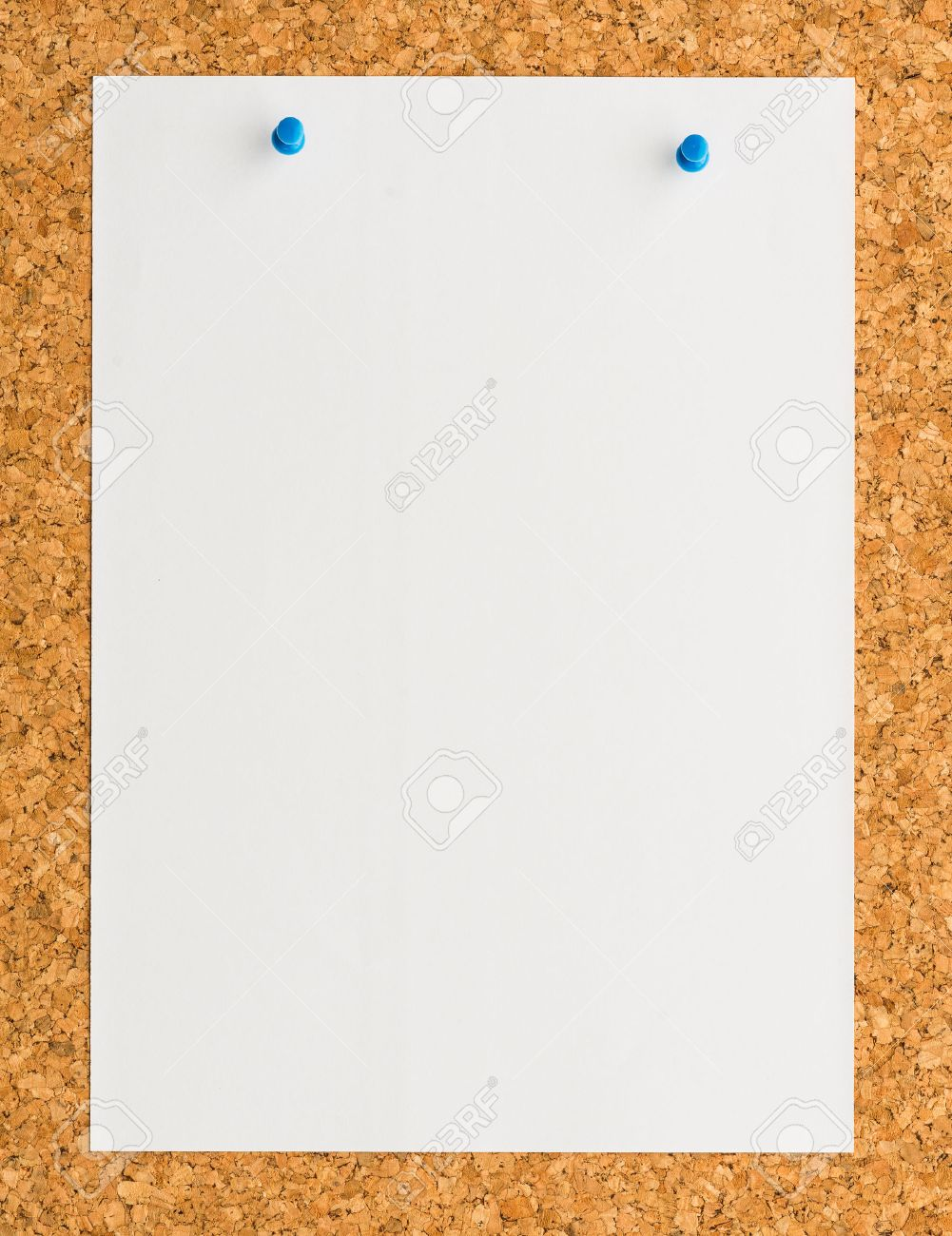 Close Up Blank White Paper Note Sheet With Blue Push Pin On Cork 1001x1300