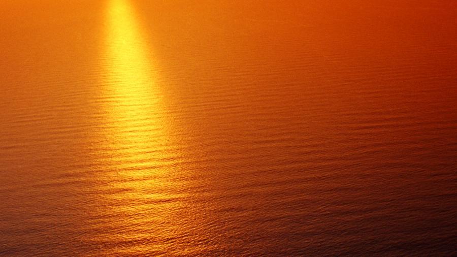 Orange Sunset over Ocean Water Texture 4K Wallpaper 900x506