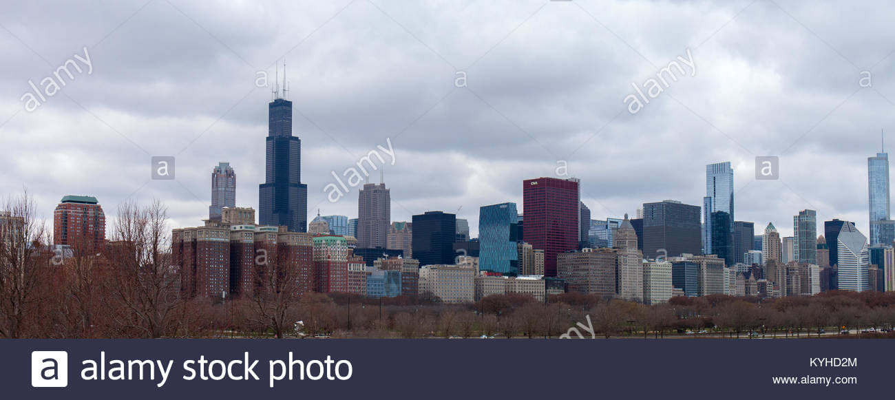 Chicago metropolis against the background of the autumn cloudy sky 1300x581