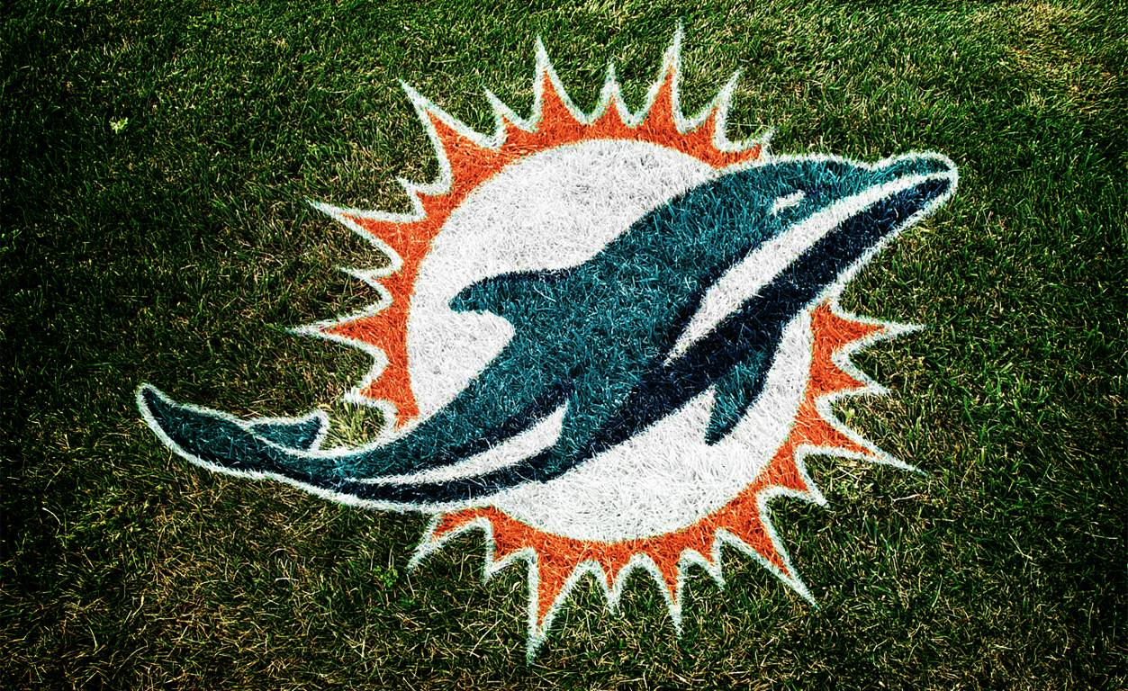 Dolphins New Logo on grass   Blogs   ThePHINScom   Miami Dolphins 1253x768