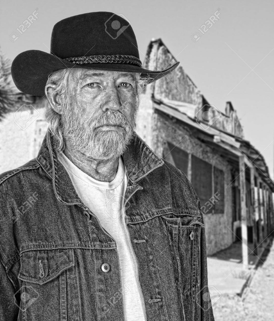 Monochrome Of A Tough Old Cowboy With A Ghost Town In The 1107x1300