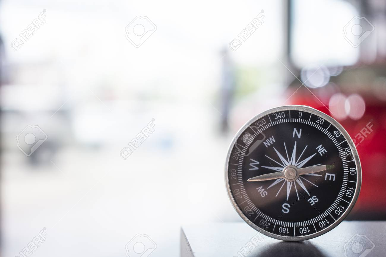 Compass On Blurry Background Using Wallpaper Or Background 1300x866