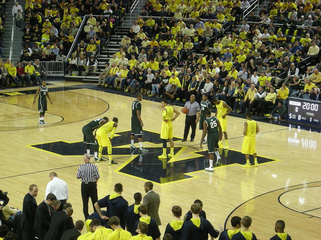 Michigan State vs Michigan mens basketball 2013 04 in game action 1024x768