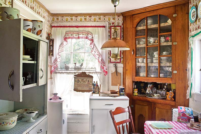 Much evolved a true farmhouse kitchen retains metal cabinets along 792x528