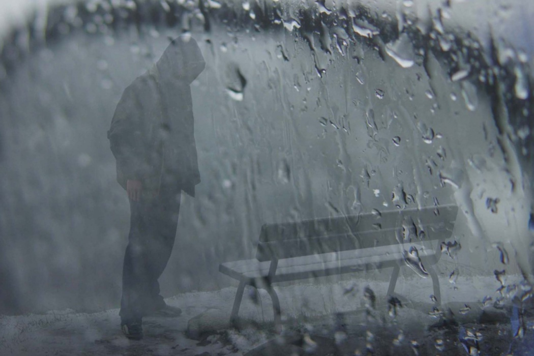 HD Sad Boy Wearing Hood Standing in Rain With Bench Wallpaper images 1050x700