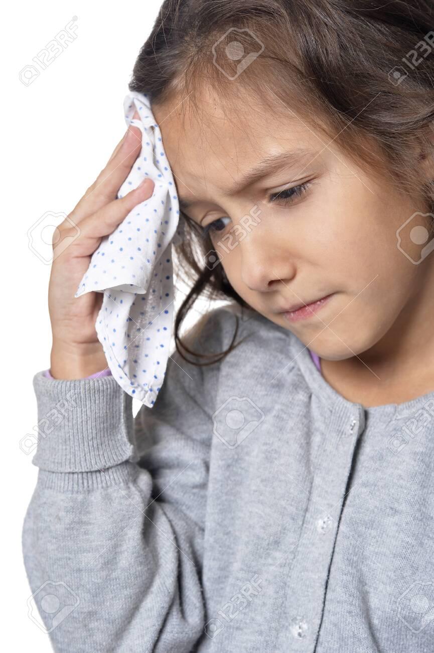 Portrait Of Sick Little Girl Holding Handkerchief On White 865x1300