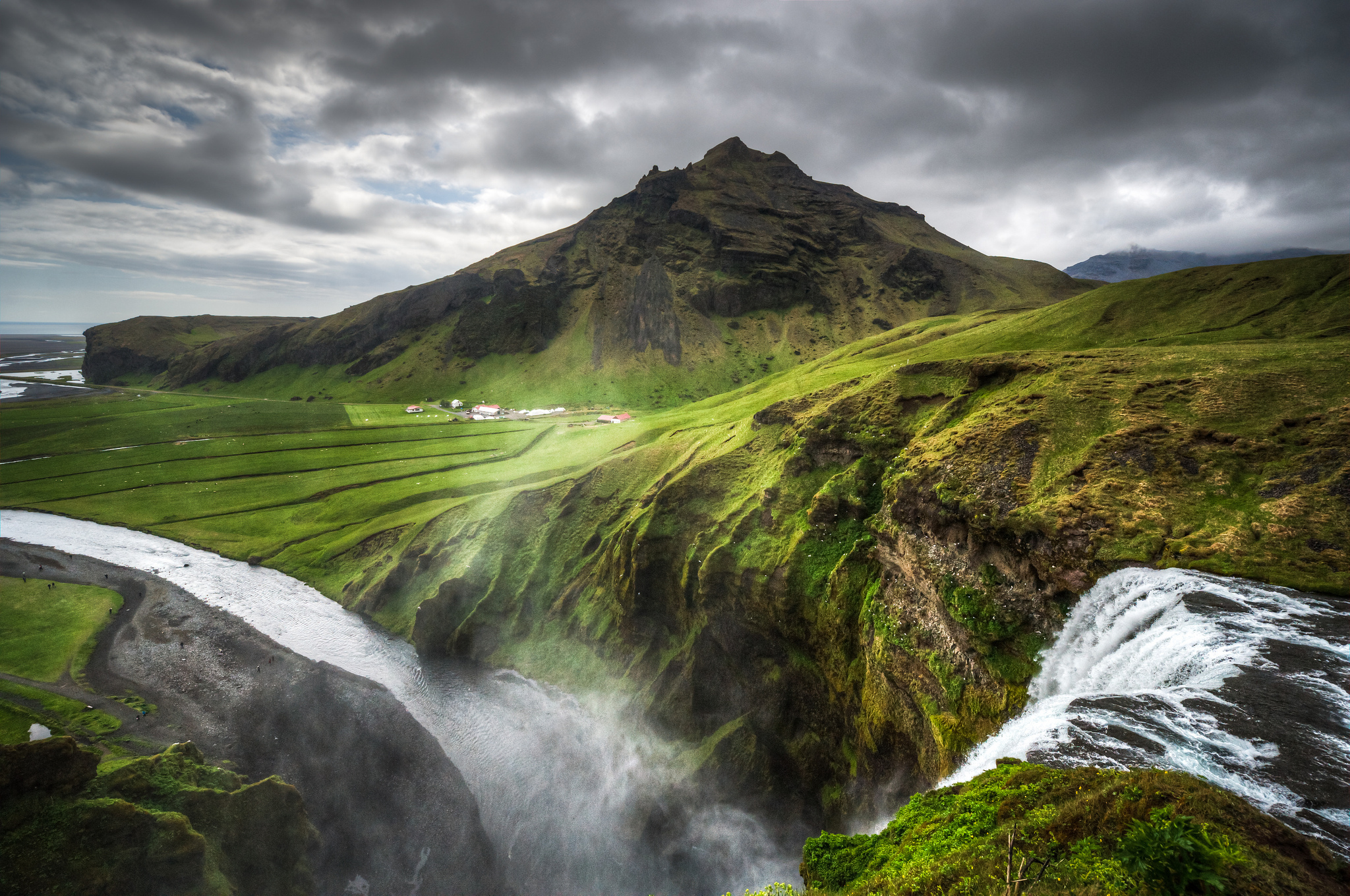Iceland nature landscapes hills mountains waterfalls grass rocks water 2048x1360