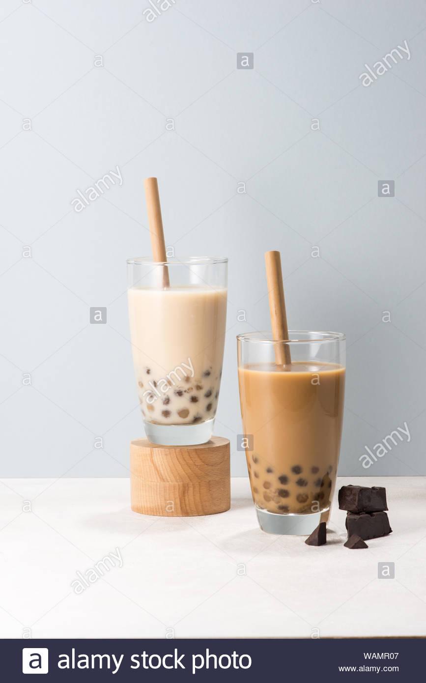 Two glasses of chocolate boba tea buble tea on white background 867x1390