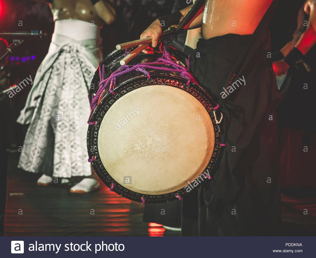 Double headed drum Taiko drums o kedo on scene background Musical 1300x1064