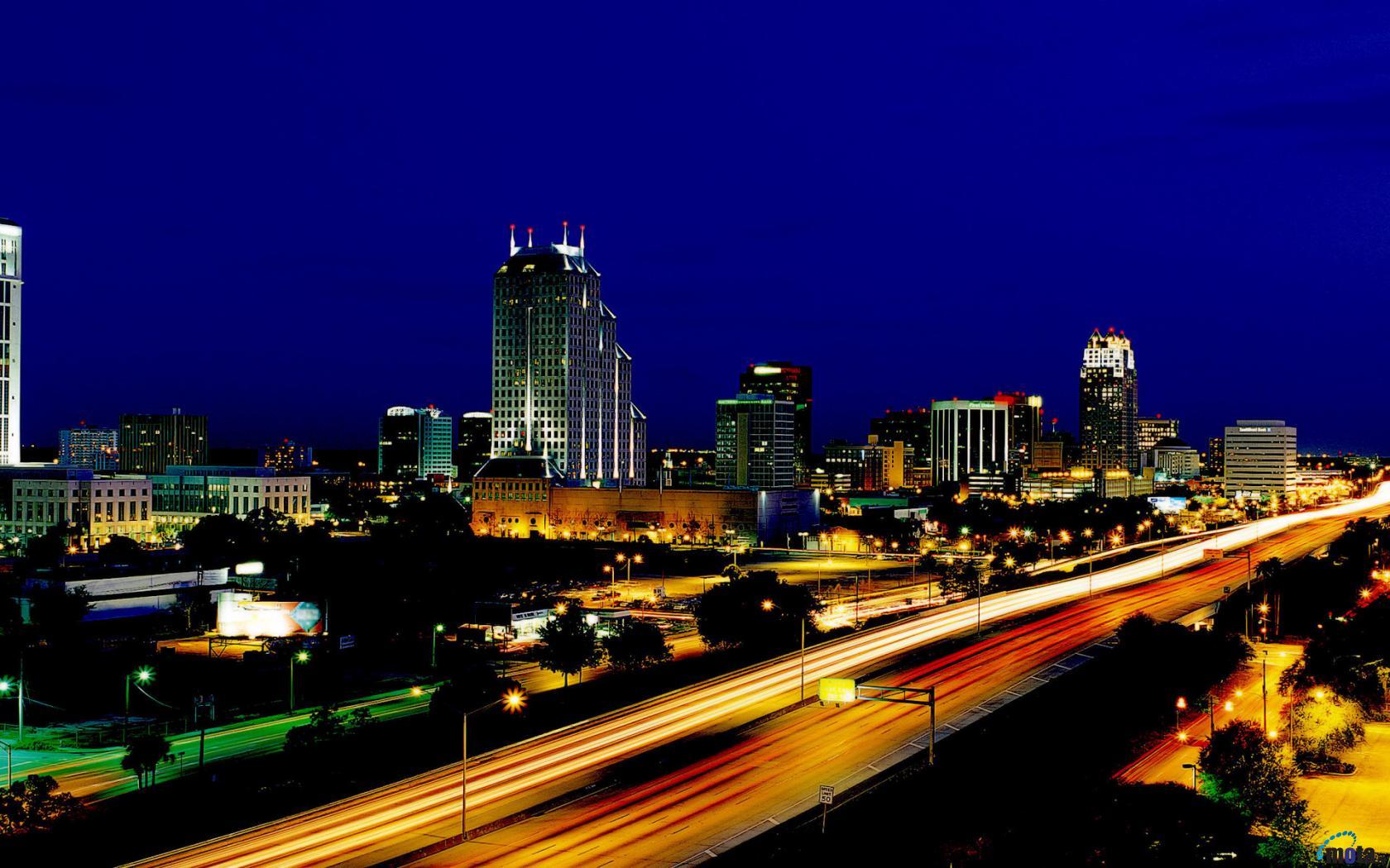 Download Wallpaper Orlando by night Florida 1680 x 1050 widescreen 1680x1050
