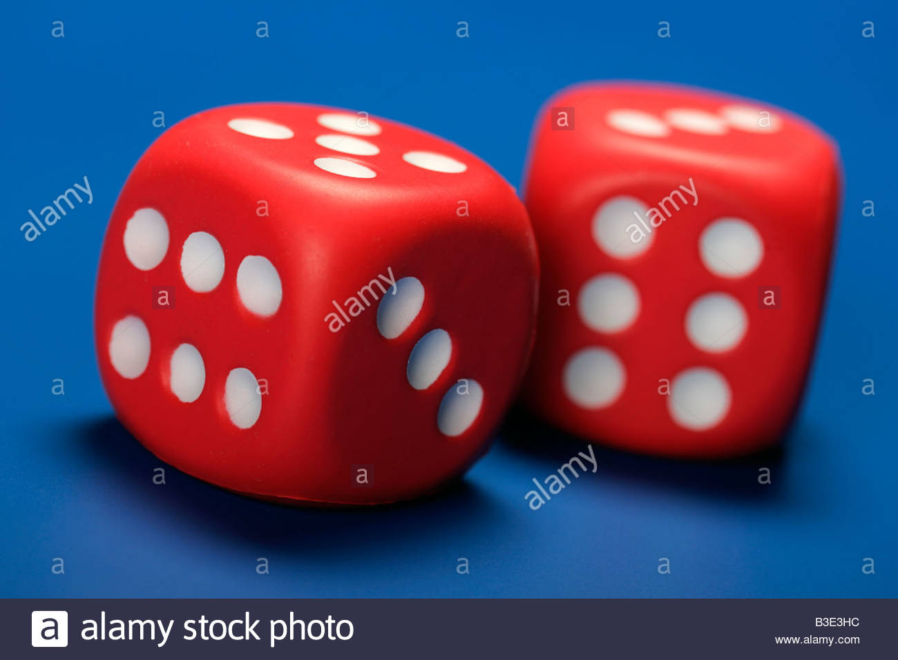 two red dice blue background gaming gambling bet casino plaything 1300x956