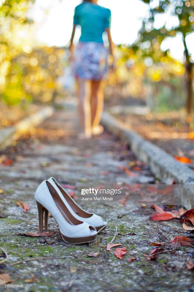 Outdoor Heeled Shoes In Autumn And Barefoot Girl In The Background 683x1024