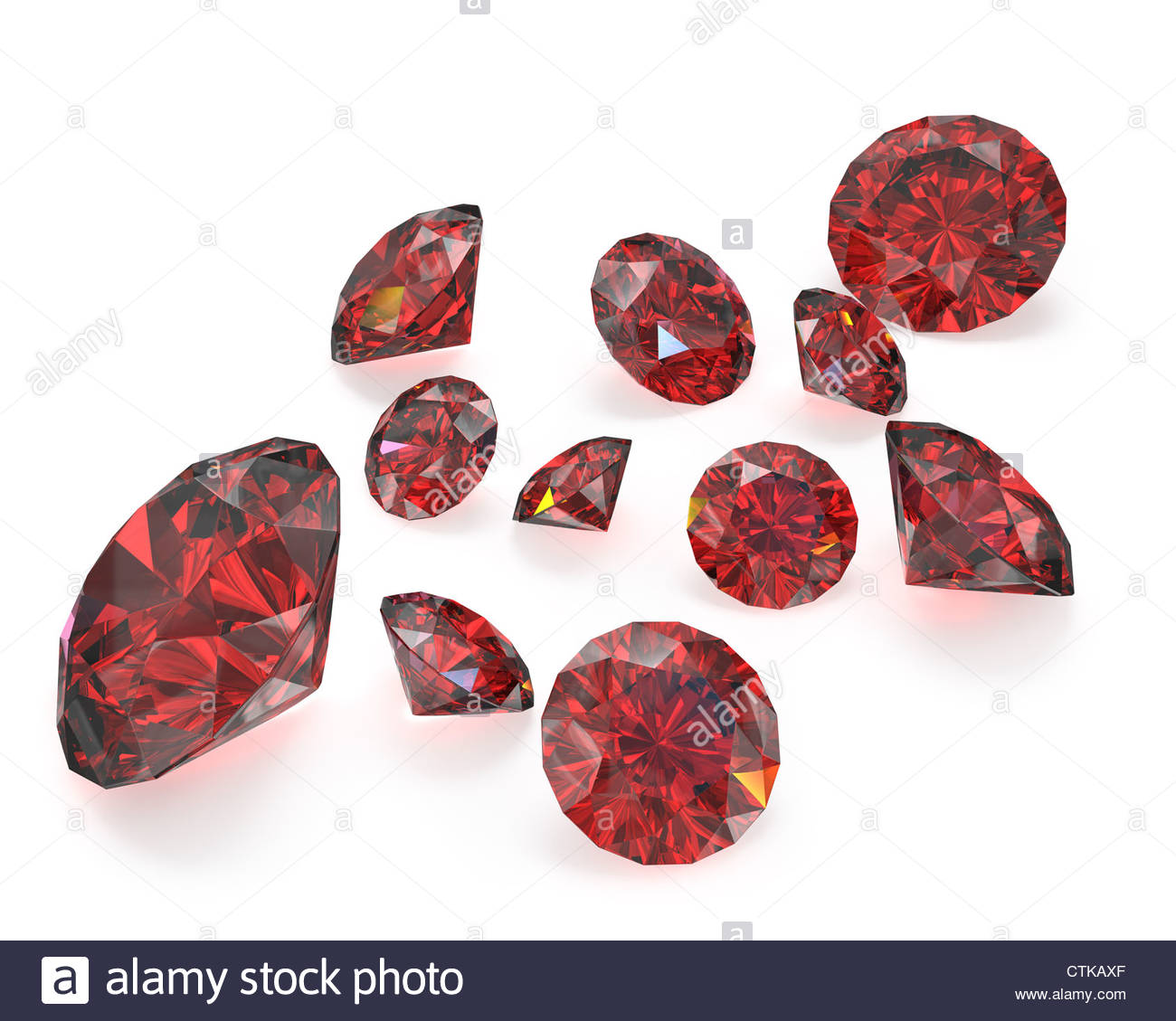 Few round cut rubies isolated on white background Stock Photo 1300x1129